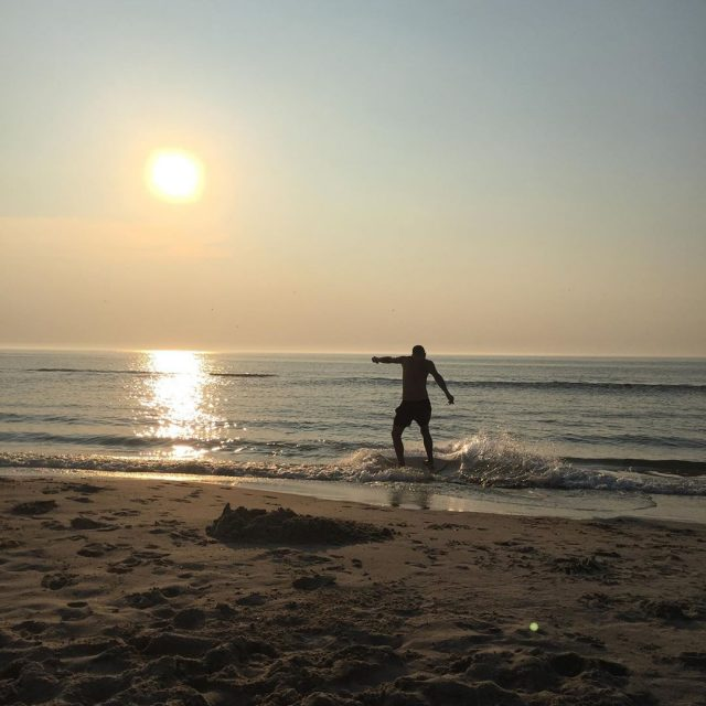 Skimboarding in the Sunset