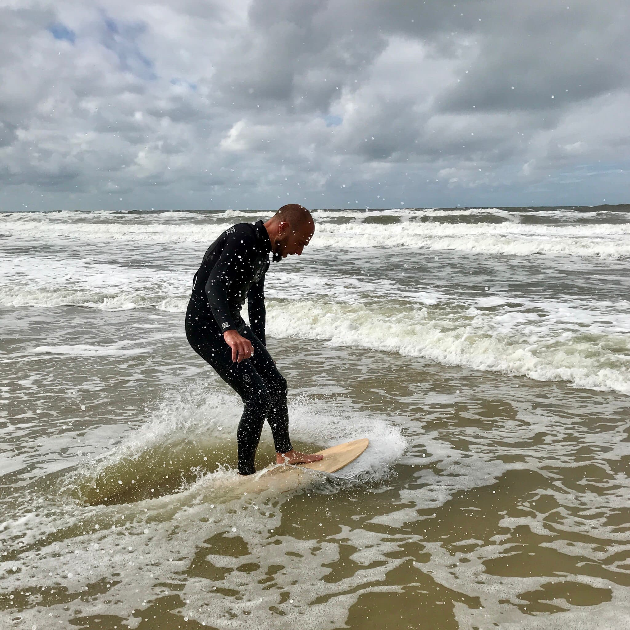 Me trying to catch a wave on a skimboard